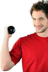 Young man with a 2kg dumbbell