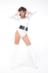 Pretty young woman dancing in white body and glossy white boots