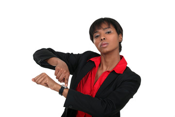 Businesswoman pointing at her watch