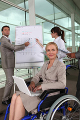 Female executive in wheelchair