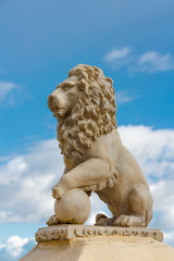 Statue of a lion against a blue sky