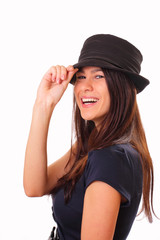 Beautiful young brunette woman in a hat