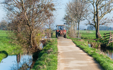 Tractor driving on a small country road