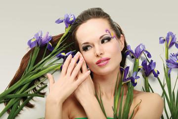 Beautiful woman with flower iris