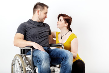 Man in wheelchair and his girlfriend is worried