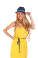 Beautiful blond woman in yellow dress and a hat