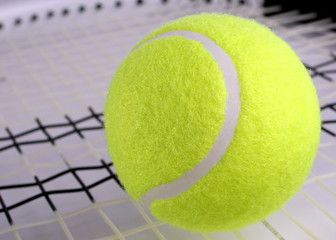 Wall Mural - Tennis ball on a racket
