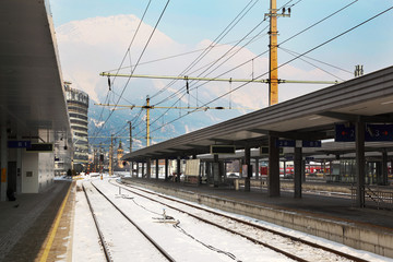 Railway station at winter at background of mountains