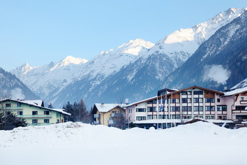 Several luxury hotels in mountains in winter.