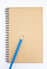 Blue pencil on brown notebook's cover.
