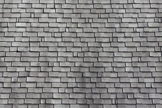 Worn asphalt shingles