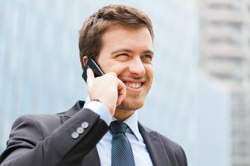 Businessman talking at the phone outdoor