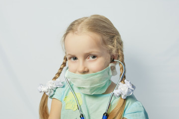 little caucasian blond girl wearing medical mask