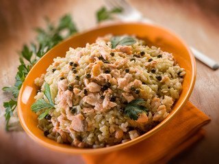 risotto with fresh salmon and green pepper, selective focus