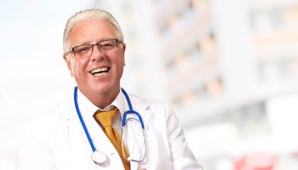 Happy Senior Doctor With Stethoscope