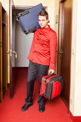 Tired Bellboy with Luggages