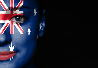 Portrait of a woman with the flag of the Australia on face.