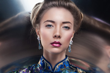 portrait of  beautiful  fashion model posing in exclusive jewelr