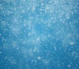 New Year's winter background with falling snowflakes and stars