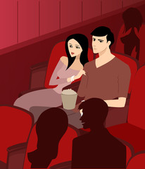 couple at the theatre watching a movie