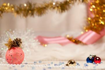 Christmas balls with pink ribbon.