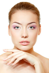 Beautiful young woman face closeup with pink soft makeup