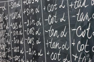 Math formulas written on the desk