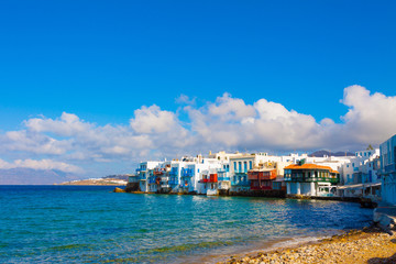 Little venice  and white clouds Mykonos Island Greece cyclades