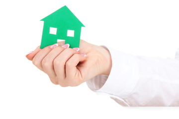concept: woman hand with paper house, isolated on white