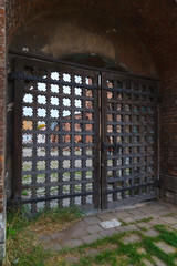 Russian carved wooden gate into the churchyard