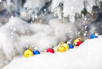 Christmas balls on snow