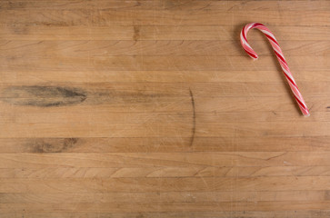 Candy Cane on Worn Cutting Board