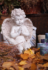 Angel figurine still life in autumn leaves