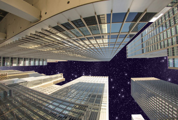 Wall Mural - Street level view of Tall Skyscrapers in Manhattan night - New Y