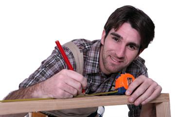 Man measuring furniture