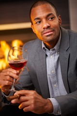 Handsome black man with cigar and a glass of wine
