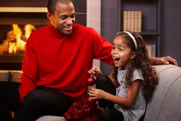 Father and happy little daughter at christmas time