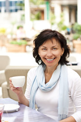 Cute young woman with a cup of coffe