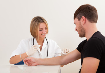 Nurse making injection to patient