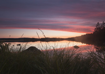 Misty morning, sun rising over a Lake in Sweden