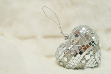 Holiday Decorations - silver mirror heart on white fur