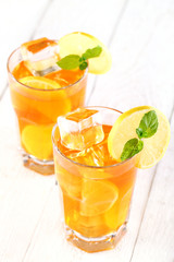 Fresh and cold ice tea with lemon and mint