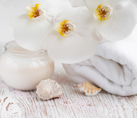 Moisturizing cream with  orchids and towel