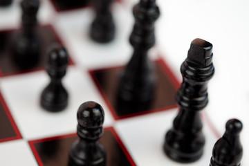 Black chessmen standing