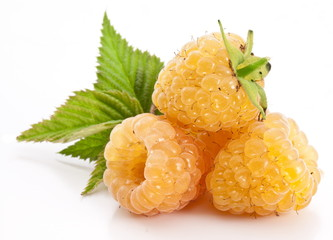 Yellow raspberries isolated on a white background.