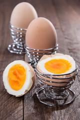 Row of eggs on wood