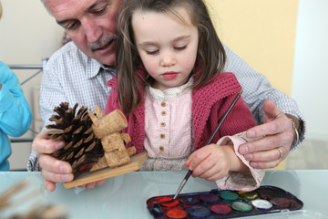 Granddaughter and grandfather painting