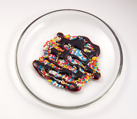 colorful sweets with chocolate sauce on plate