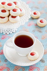 Cup of hot tea and homemade almond cookies