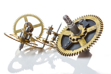 gears from old clock isolated on white background